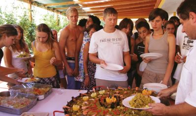 Students getting Paella