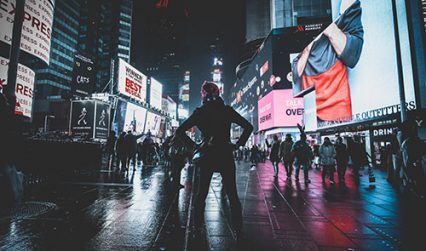 Party Leader standing in Times Square