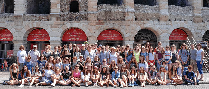 Testbourne group photo outside the Roman Colosseum in Verona