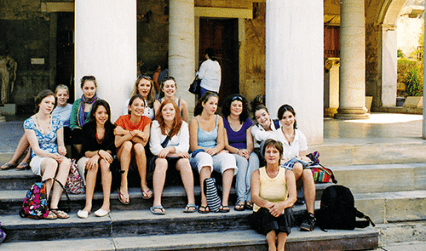 Students sitting on steps, Greece