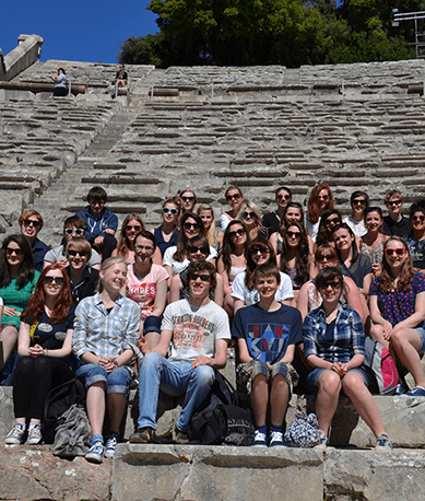 Students sitting on the steps of amphitheatre, Athens
