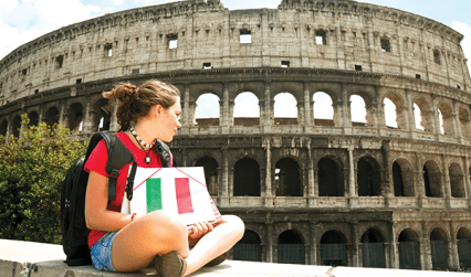 Student holding Italian flag outside the Colosseum, Rome