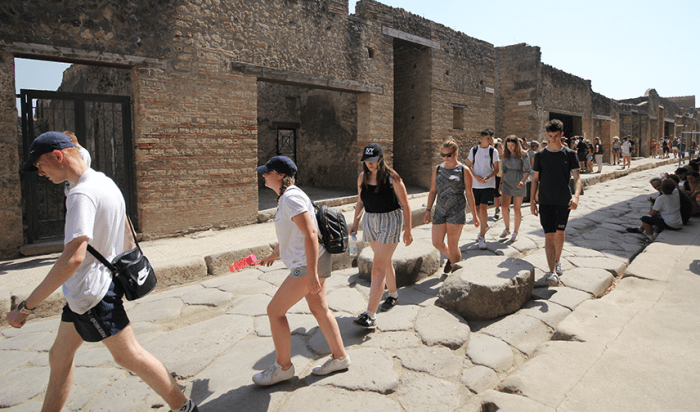 Students walking through Pompeii