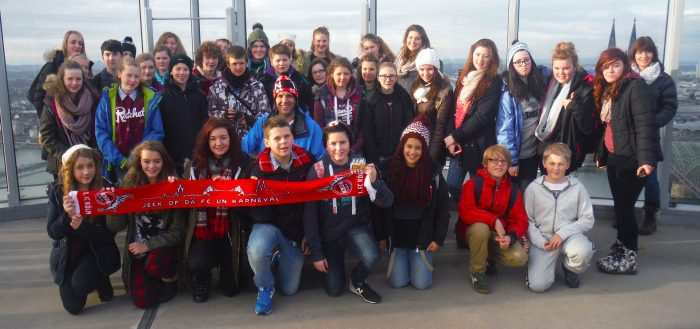School group holding Cologne scarf