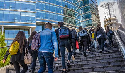 Students walking up steps in Brussels