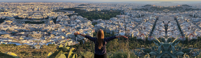 Student overlooking Athens